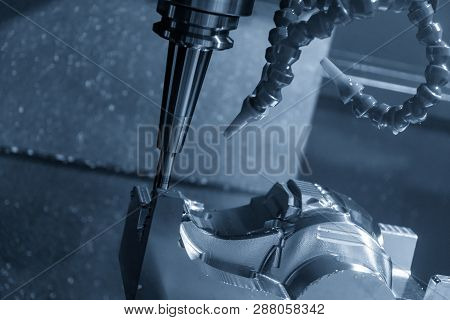The  Cnc Milling Machine Cutting The Mould Part With The Solid Ball End Mill Tool.the Hi-technology