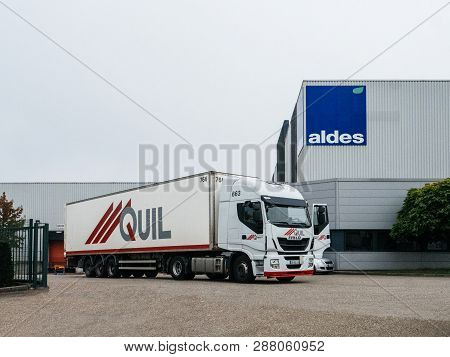 Strasbourg, France - Sep 21, 2017: Aldes Warehouse Building With Iveco Truck And Quil Trailer Parked