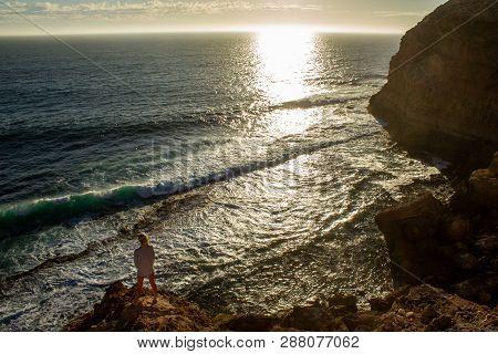 Jung Women Standing On Cliffs Near Port Lincon At Sunset, South Australia