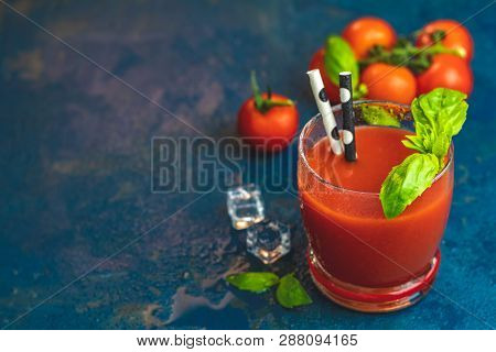Red Cocktail With Tomato Juice Between Tomatoes, Fresh Basil And Ice. Delicious Tomato Bloody Mary C