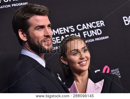LOS ANGELES - FEB 28:  Liam Hemsworth and Miley Cyrus arrives to