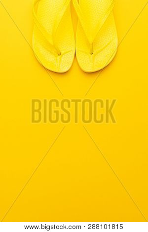 Beach Flip-flops On The Yellow Background With Copy Space. Summer Concept