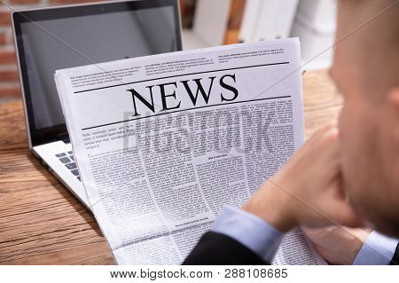 Young Man Reading News Paper