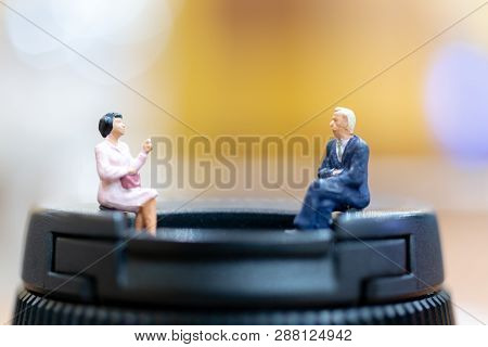 Miniature People : Businessman And Woman Sitting On Chair And Copy Space For Text
