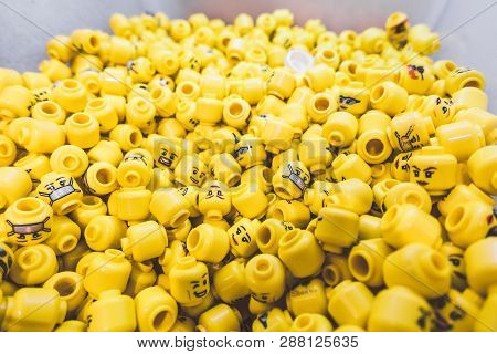 London, England-14 October, 2018: Group Of Yellow Minifigure Lego Heads Toy In The Lego Store At Lei
