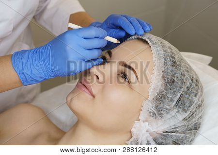 Aesthetic Cosmetology. Facelift In Spa Salon. Beautician Makes Markup For Injection. Smoothing Of Mi