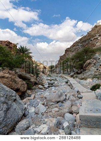 Parched Riverbed Called Wadi In Asia, In The Outskirts Of Muscat, Oman