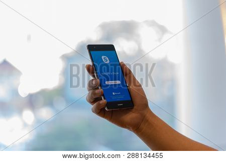Chiang Mai, Thailand - Oct. 28,2018: Man Holding Huawei With Skype Apps. Skype Is Part Of Microsoft,