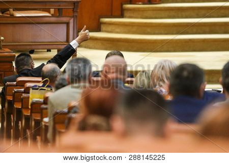 Bucarest, Romania - July 4, 2018: The Lider Of A Parliamentary Group Signals To His Coleagues How To