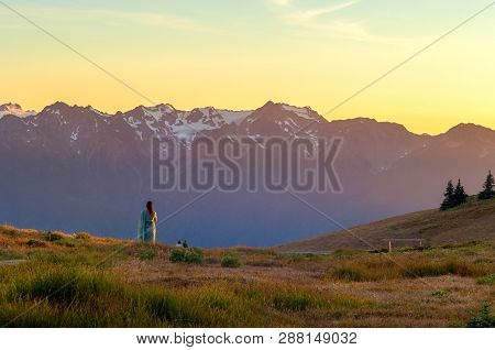 Visitors Watching Sunset Over Snow Capped Mountains Of Hurricane Ridge In Olympic National Park, Was
