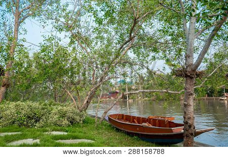 Rowboat On The Brae Beside Of Canal With Thai Lifestyle, Countryside Of Thailand