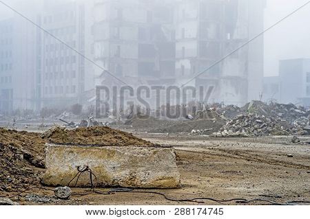 The Remains Of A Large Concrete Building In The Form Of Fragments Of Piles And Piles Of Stones.