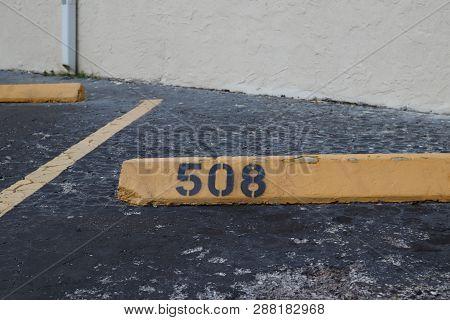 Number 508 Black On Yellow. Asphalt On The Background. Black Number Stencil Painted On Backdrop, Num
