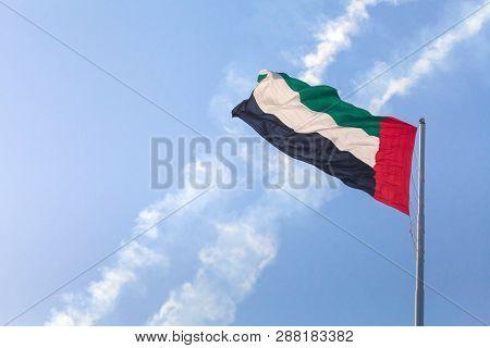 Uae Flag Waving In The Sky, National Symbol Of Uae. Uae Flag Day.