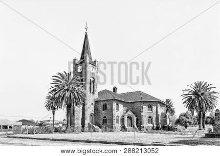 Vredefort, South Africa, August 2, 2018: A Street Scene, With The Dutch Reformed Church, In Vredefor