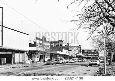 Virginia, South Africa, August 2, 2018: A Street Scene, With Businesses And Vehicles, In Virginia In