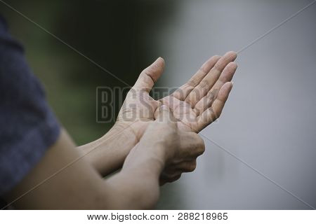 Woman Holding Her Hand. Pain In A Woman Hand. Female Massaging Painful Hand For Painful Concept.