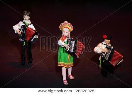 MOSCOW - MARCH 17: unidentified Kids play music at concert of Gennady Ledyakh School of Classical Dance in theater Et Cetera, on March 17, 2011 in Moscow, Russia. Concert held for winners in competition.