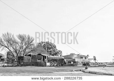 Theunissen, South Africa, August 2, 2018: A Street Scene, With An Historic Class 16da Steam Locomoti