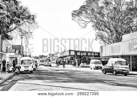 Theunissen, South Africa, August 2, 2018: A Street Scene, With Businesses, Vehicles And People, In T