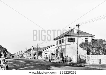 Brandfort, South Africa, August 2, 2018: A Street Scene, With Businesses, Vehicles And People, In Br