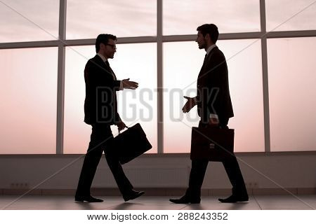 businessmen stretching out their hands for a handshake