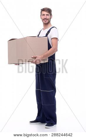 man in a jumpsuit holding a large box