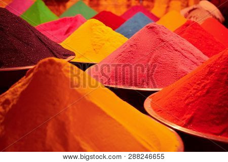 Abstract Colourful Happy Holi Background. Holi Colour Powder (gulal), Arranged In A Pyramid Structur
