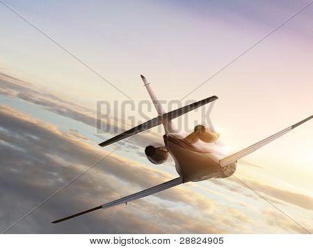 Jet-Flugzeug auf Sonnenuntergang