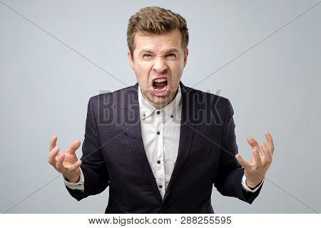 Anger Crazy Handsome Man In Suit Standing Shouting Or Screaming