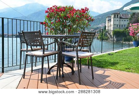 Table in a cafe against Como lake