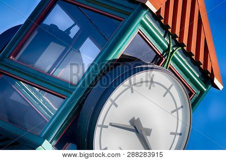 Abstract Clock Tower With Blue Sky In Daylight