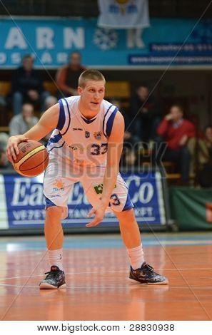 KAPOSVAR, HUNGARY - NOVEMBER 19: Nik Raivio in action at a Hugarian National Championship basketball game Kaposvar (white) vs. Paks (red) November 19, 2011 in Kaposvar, Hungary.