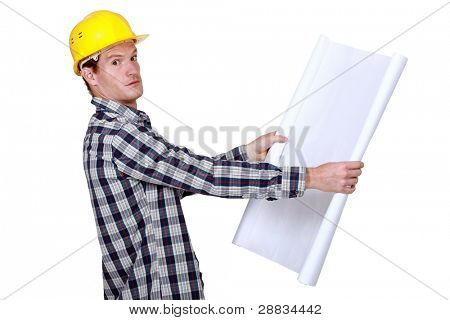 Builder going over construction plans