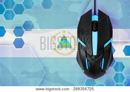 Nicaragua Flag  And Computer Mouse. Concept Of Country Representing E-sports Team