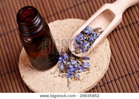 Dried caledula lavender petals with macerated oil on the stone mat