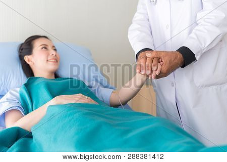 Hands Senior Man Doctor Reassuring Her Female Patient In Hospital Room,doctor Giving A Consultation