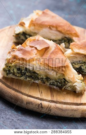 Spanakopita, greek phyllo pastry pie with spinach and feta cheese filling