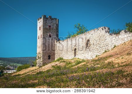 Old Fortress Caffa In Feodosia, Crimea, Russia. Panorama Of The Genoese Fortress Ruins On The Southe