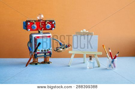 Robot Artist Begins To Create A Drawing. White Paper Mockup, Wooden Easel And Artists Tools Palette,