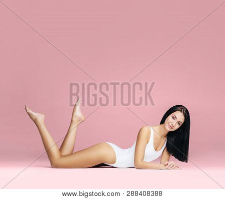 Fit And Sporty Girl In Underwear. Beautiful And Healthy Woman Posing In White Swimsuit. Slim Body. S