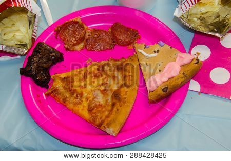 Birthday Party Food With One Bite Taken From Assorted Treats Including Pizza, Chips, Cookie Cake And