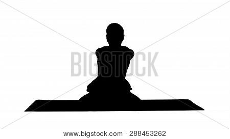 Silhouette Sporty Beautiful Young Man Practicing Yoga, Sitting Cross-legged In Adho Mukha Padmasana,