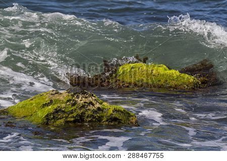 Storm Surges Of The Sea Washed The Rocky Beach With Views Of The Mountains. Black Sea Coast Of Russi