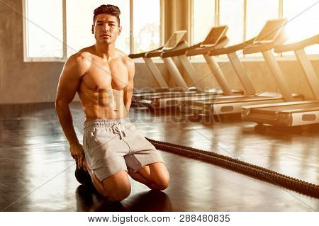 Muscular Bodybuilder Guy Tired Showing His Muscle Body  Taking A Break From Running Or Exercise Sitt