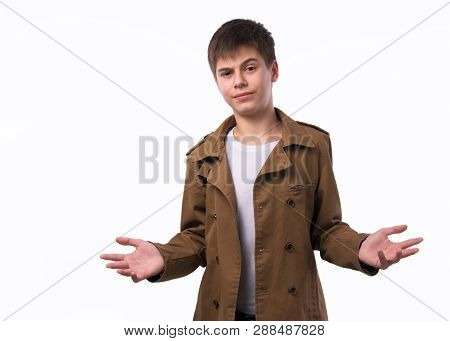 Portrait Of Surprised Teen Boy With Divorced Raised Hands Isolated On White Background.
