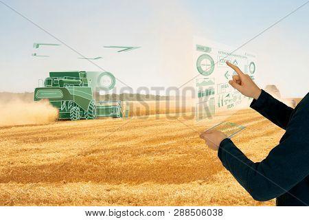 Farmer Uses A Futuristic Projection Touch Screen To Control Autonomous Harvester. Smart Farming Conc