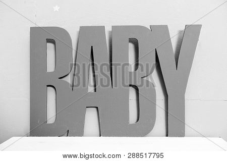 Baby. Beautiful Decorations For Baby Shower Party. The Inscription Made Of Wood Baby. Childhood Happ