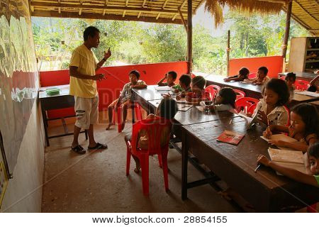 KO CHANG, THAILAND - JANUARY 6: Unidentified children in lesson at school by project Cambodian Kids Care to help deprived children in deprived areas with education, on January 6, 2012 in Ko Chang, Thailand