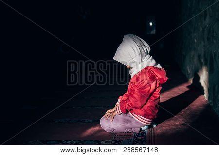 Muslim Little Girl Praying In Mosque